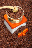 Coffee grinder. On coffee beans background stock photo