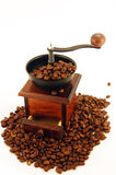 Coffee grinder. Stylish coffee grinder with pile of coffee beans Stock Image