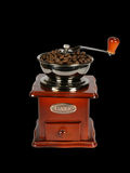 Coffee-grinder. With coffee beans isolated on black Stock Photos