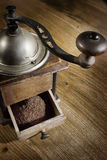 Coffee grinder. On oak table Royalty Free Stock Images