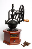 Coffee Grinder. Mechanical Coffee Grinder and toasted grains Royalty Free Stock Photos