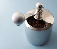 Coffee Grinder. Of steel on a blue bg Stock Photo