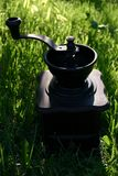 Coffee grinder. On the grass in garden Royalty Free Stock Photography