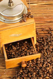Coffee grinder. Old fashioned coffee grinder and coffee beans Stock Images