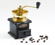 Coffee grinder. With coffee seeds on white background Royalty Free Stock Photo