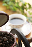 Coffee grinder. And cup on wooden table Royalty Free Stock Photography