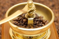 Coffee-grinder. Old brown coffee-grinder with coffee beans Royalty Free Stock Photos