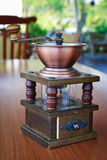 Coffee grinder. Retro coffee grinder on the table Royalty Free Stock Photos