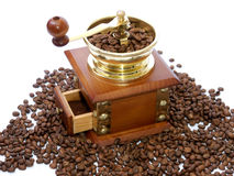 Coffee-grinder. With coffee beans on the white Royalty Free Stock Images