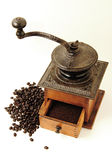 Coffee grinder. And coffee beans on white background Royalty Free Stock Image