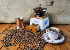 Coffee Grinder. Beautiful old-styled image of Coffee Grinder and cup Royalty Free Stock Photos