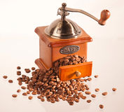 Coffee grinder. Old coffee grinder with beans Royalty Free Stock Photography