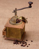 Coffee grinder. And beans in vintage style Royalty Free Stock Images