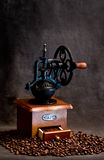 Coffee grinder. Vintage style coffee grinder and coffee beans Stock Photos