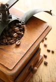 Coffee Grinder. Coffee beans in an antique grinder Stock Photo