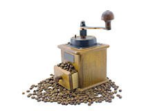 Coffee grinder. �coffee grinder and scattered grains of coffee isolated on the white Royalty Free Stock Photos
