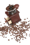Coffee grinder. And coffee grains on a white background. The isolated object Royalty Free Stock Images