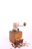 Coffee-grinder. Converts banknote into coins against a white isolated background wit copy-space Stock Photography