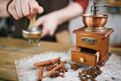 Coffee grinder and aromatic flavorings Stock Photo