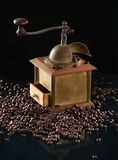 Coffee grinder and beans. On a dark background Stock Images