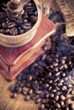 Coffee grinder. And coffee beans stock images