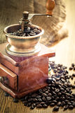 Coffee grinder. And coffee beans royalty free stock image