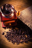 Coffee grinder. And coffee beans royalty free stock photography