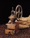 Coffee Grinder and Beans. Coffee Grinder, burlap and beans stock image