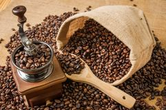 Coffee grinder beans and bag Royalty Free Stock Photo
