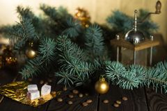Coffee grinder, coffee beans and Christmas tree branch on a wooden table Stock Photography