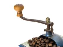 Coffee grinder and beans. Close up of a coffee grinder with coffee beans on white background Royalty Free Stock Image