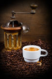 Coffee Grinder with Beans and coffe cup Royalty Free Stock Photos