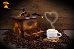 Coffee Grinder with Beans and coffe cup Stock Photo