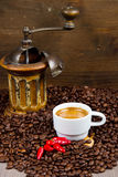 Coffee Grinder with Beans and coffe cup Royalty Free Stock Image