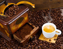 Coffee Grinder with Beans and coffe cup Royalty Free Stock Photography