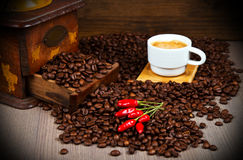 Coffee Grinder with Beans and coffee cup Royalty Free Stock Image