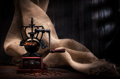 Coffee grinder and beans coffee. In the rustic style with burlap Royalty Free Stock Photos