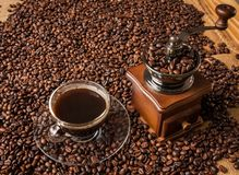 Coffee grinder beans and cup of coffee Stock Photography