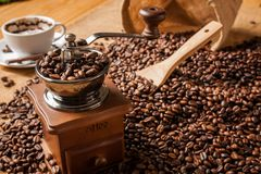 Coffee grinder beans and cup of coffee Royalty Free Stock Images