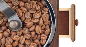 Coffee grinder with beans and ground closeup Royalty Free Stock Photography