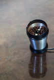 Coffee grinder with beans. A coffee grinder with beans inside Stock Images