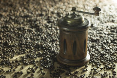 Coffee grinder. With coffee beans on jute cloth Stock Photos