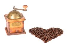 Coffee grinder with coffee beans in the shape of a heart.  Stock Photography