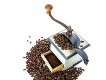 Coffee grinder and beans. Top view of an old coffee grinder with coffee beans on white background Stock Image