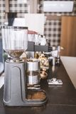 Coffee grinder in the cafe on the bar counter , vertical frame.  stock photo