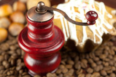 Coffee grinder, cake with icing, nuts and coffee Stock Photo