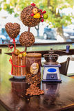 Coffee grinder, candle. coffee tree Royalty Free Stock Photos