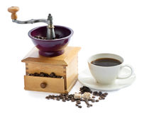 Coffee grinder and coffe cup Royalty Free Stock Image