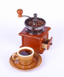 Coffee-grinder and coffee. Coffee-grinder with coffee beans and coffee on white background Royalty Free Stock Photos