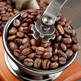 Coffee grinder with coffee beans. Close up Royalty Free Stock Image